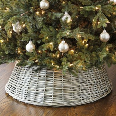 Willow Christmas Tree Basket - something different than that ill-fitting tree skirt. Go one better -- re-purpose an old basket by cutting out bottom and spray-painting. Get creative.