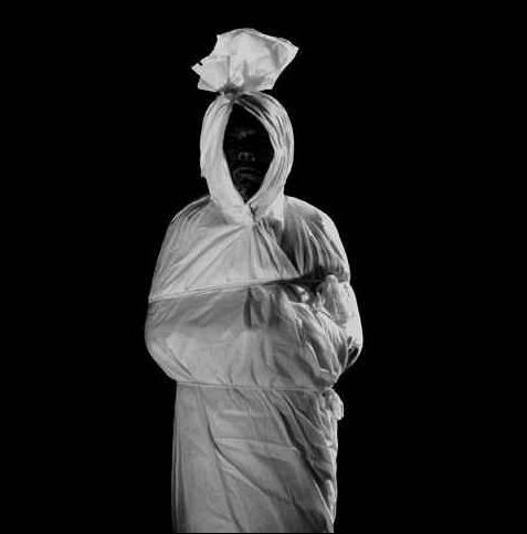 Pocong- Malaysian legend: a type of ghost that pops out of its grace that hasn't been unwrapped from its bands in 40 days. It hops around demanding to be unwrapped. When it is unwrapped, it will disappear.