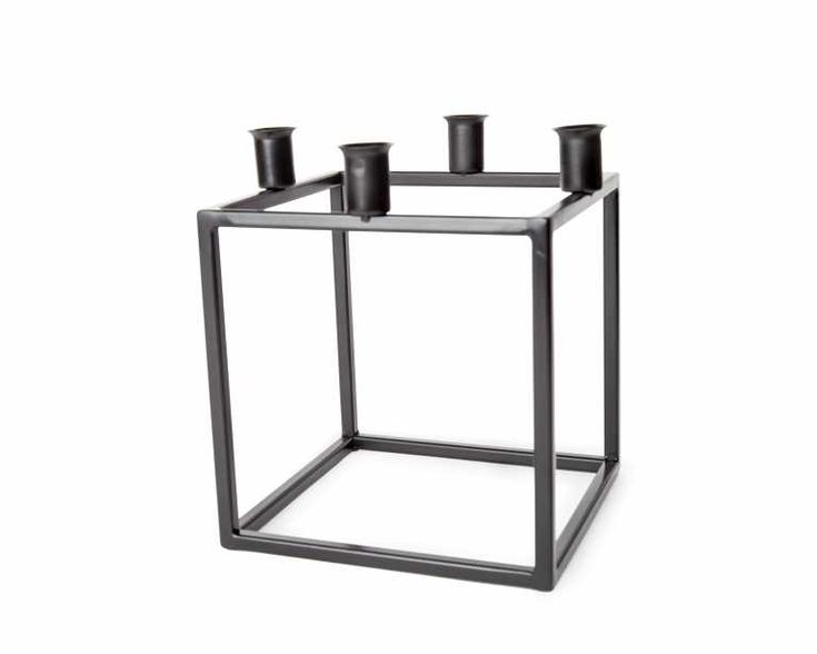 The Quad Metal Candle Holder is cubist, modern and traditional.