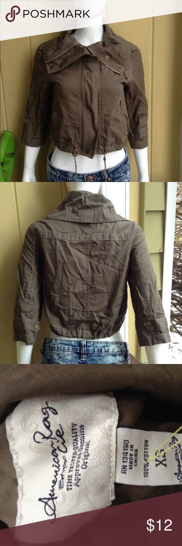 American Rag cropped Jacket XS This is an Olive green Cropped jacket from American rag. It both zips and buttons up and has zip up pockets. It does not have a hood. Very good condition, no holes or stains American Rag Jackets & Coats Utility Jackets