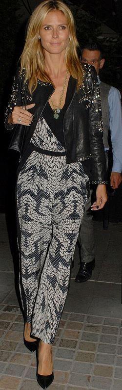 Heidi Klum, white print wrap jumpsuit and black studded leather jacket