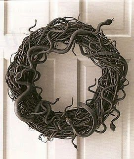 Plastic snakes glued to a wreath and spray painted black.