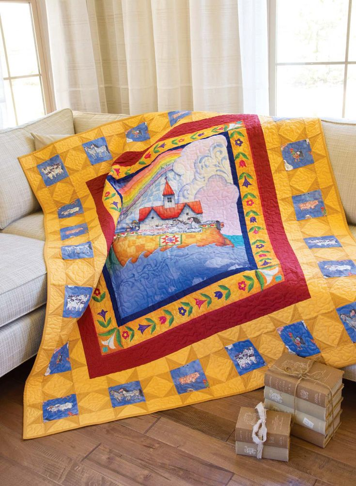 """Starry Storm Quilt Kit: A Noah's Ark-themed fabric panel designed by Jim Shore is surrounded by stars on this 60"""" x 70"""" throw quilt. This design goes together quickly because of easy piecing!"""