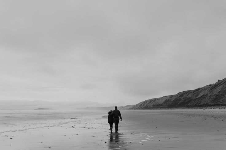 We're in this together... one of my favourites from this engagement shoot taken in Rhossili Bay, Gower Peninsula. Photo by Benjamin Stuart Photography #weddingphotography #love #gower #engagement #blackandwhite