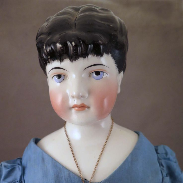 This is a very uncommon 25 inch tall model of German china shoulder head doll made by C. F. Kling circa 1870s, marked with model number 148 and size