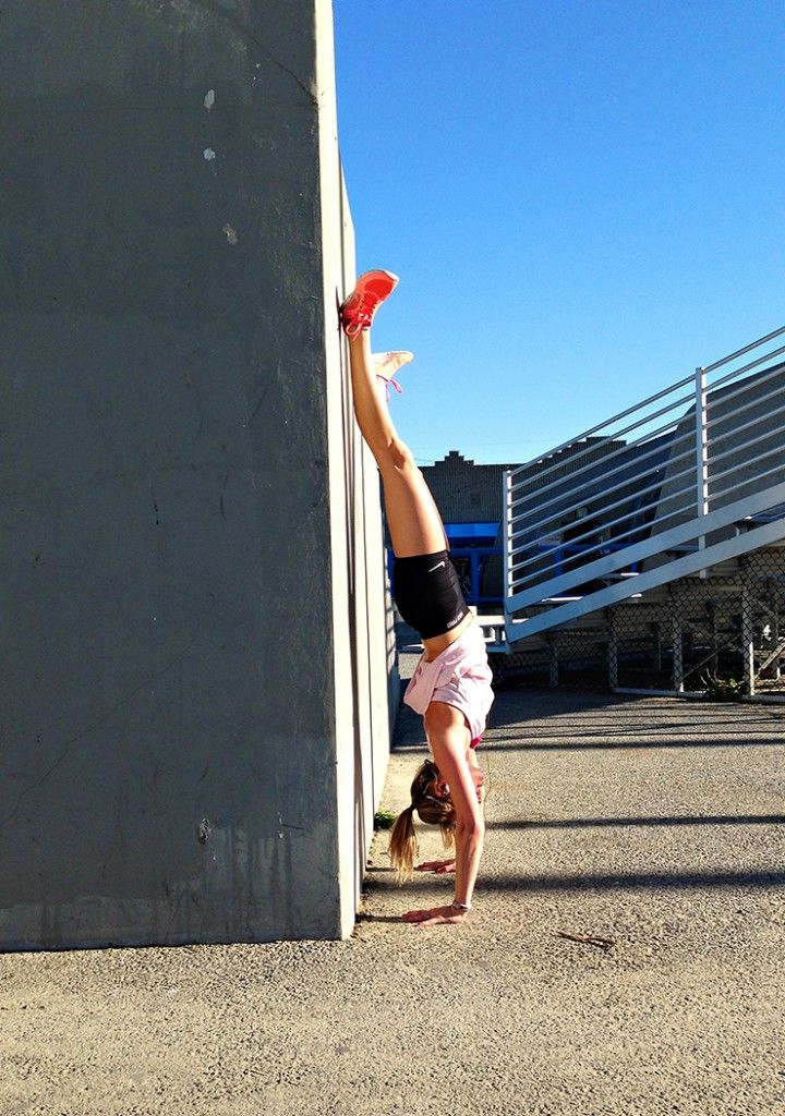 Here's why you should do handstands on a regular basis—and how to get started doing them.