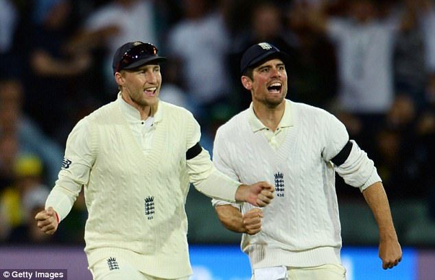 England players including Joe Root andAlastair Cook (right) wore black armbands