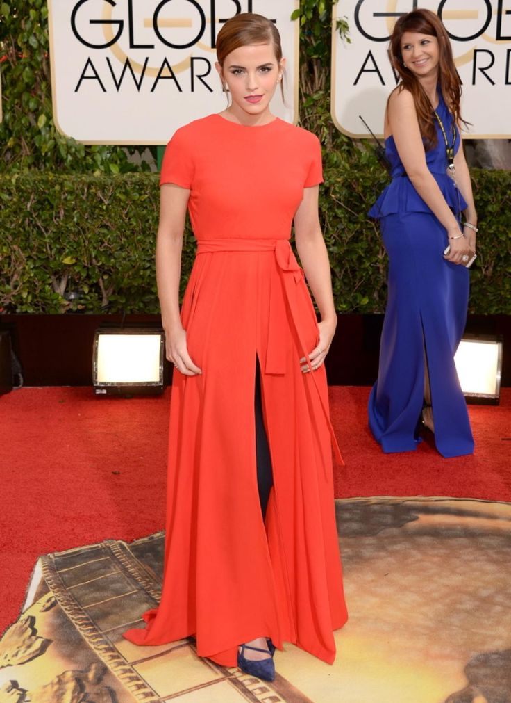 Emma Watson couldn't choose between pants and a dress as she was getting ready for the Golden Globe Awards so she decided just to wear both -- the actress is wearing black trousers underneath her backless Dior gown.