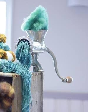 Creating yarn in meat grinder. LOL