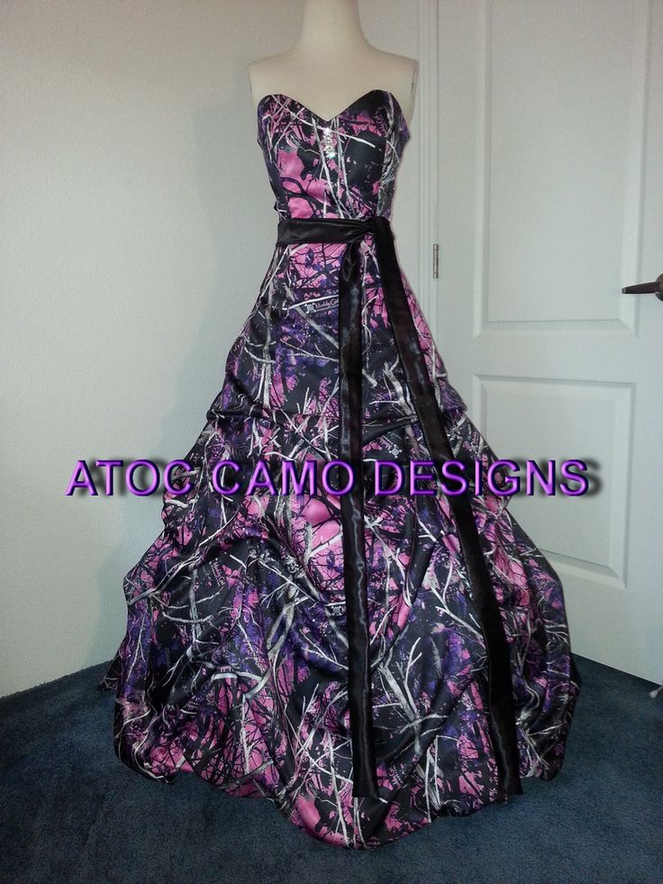 $435   ATOC-AE-18 named Katlyn. Strapless, corset back, sash and small sweep train included.  Shown in Muddy Girl camo
