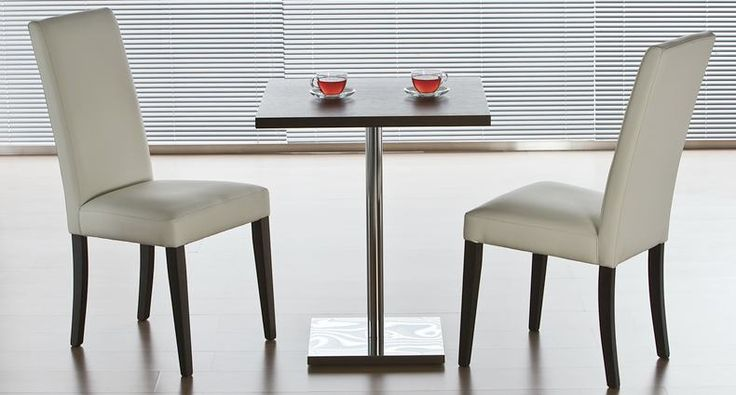 The contemporary Ravenna dining chair is made in Italy to the highest standards. The modern high back and deeply padded seat make this both elegant and comfortable. Upholstery options are wide - choose from faux or soft split leather in a great variety of colours. The Ravenna has solid wooden legs which is a classic combination with leather. £152.00