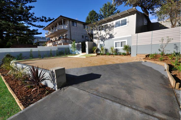 New concrete driveway and granite gravel parking area