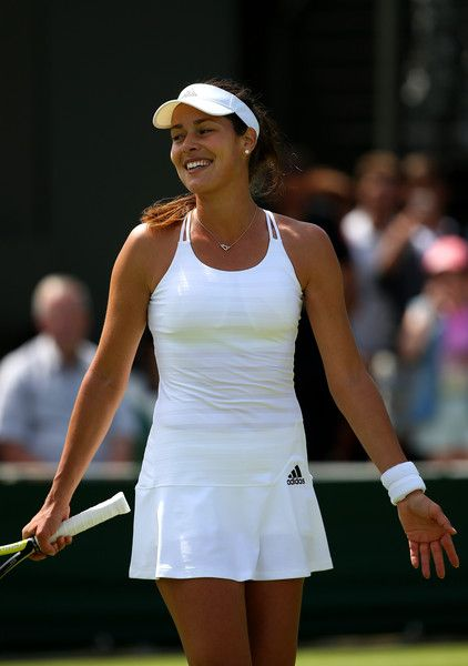 Ana Ivanovic Photos - Ana Ivanovic of Serbia celebrates winning her Ladies's Singles first round match against Yi-Fan Xu of China during day one of the Wimbledon Lawn Tennis Championships at the All England Lawn Tennis and Croquet Club on June 29, 2015 in London, England. - Day One: The Championships - Wimbledon 2015