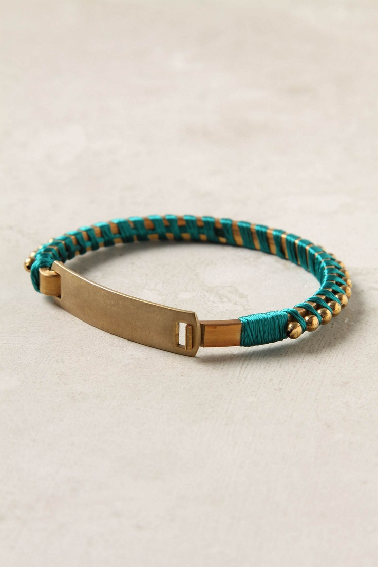 simple yet adorable metal and thread bracelet. Comes in turquoise and pink