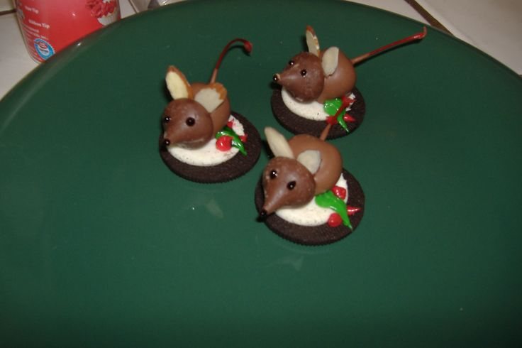 Holiday Mice !!!! They are so cute !!!  Ingredients  1 Jar Cherries With Stems On  1 Package Chocolate Bark  20 Hershey Kisses  Almond Slices  Gel Tubes Of Black And Red  20 Oreo Cookies (white Chocolate Covered, Or An Opened Cookie)