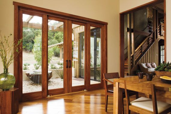 This wood patio door set from Pella is an elegant twist on the regular sliding door.  Rather than one sliding panel, both doors - which have the look of a French door - slide open.  We proudly install #PellaDoors in the Minneapolis MN area.  http://www.replacementwindowsmpls.com/