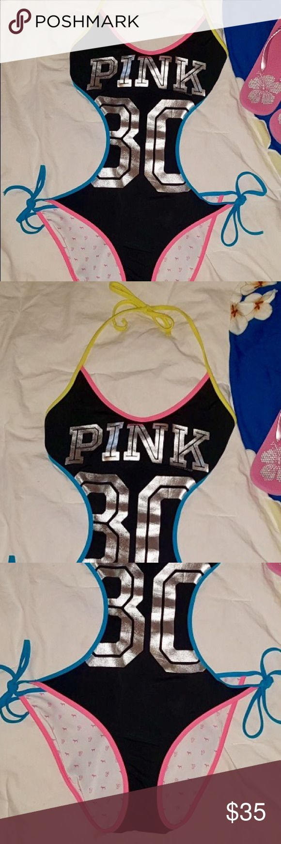 💙PINK💛One piece Swimsuit💖 Victoria's Secret 'pink' bathing suit. Size Small. One Piece with cut out sides and an open back💕. Very sexy cute, it's black with Silver writing. Hot pink trim, and turquoise & yellow straps. 🍭Thank you Gift with every order🍭 PINK Victoria's Secret Swim One Pieces