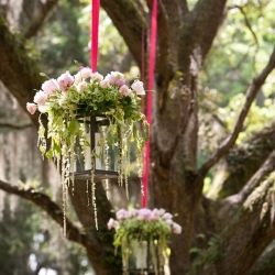 A dreamy Lowcountry wedding in Pawleys Island, South Carolina with preppy pink and green details. Use roses on top of my square and round crystal candle holders