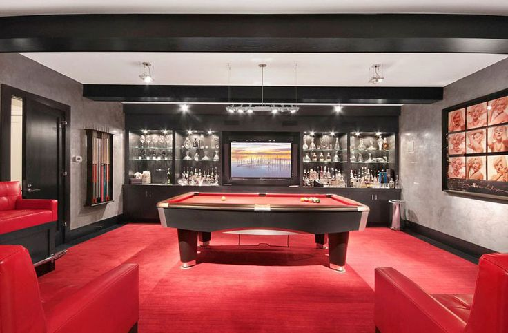 Luxury basement man cave with red pool table and black bar