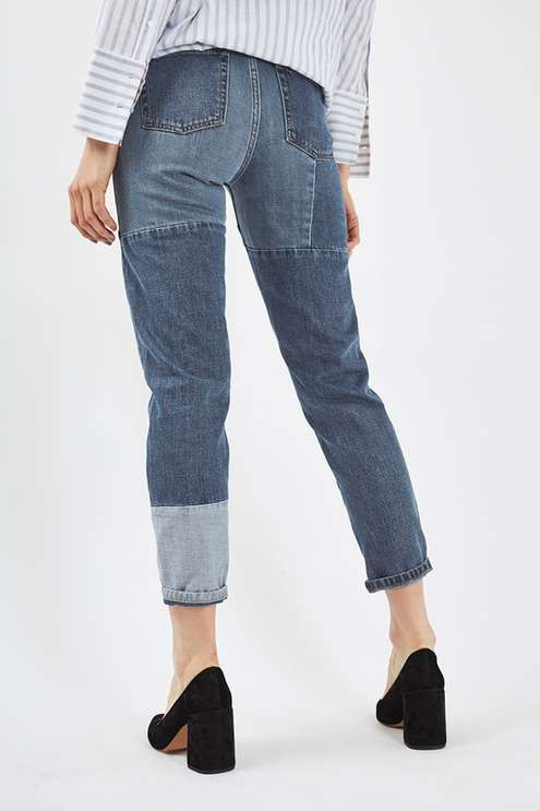 Crafted from pure cotton, our MOTO Mom jeans come in an authentic patchwork panel detail denim. Cut with a high-waist and a tapered leg, they feature multiple pockets, classic trims and ripped knees. Wear them folded at the cuffs to keep them looking cool. #Topshop