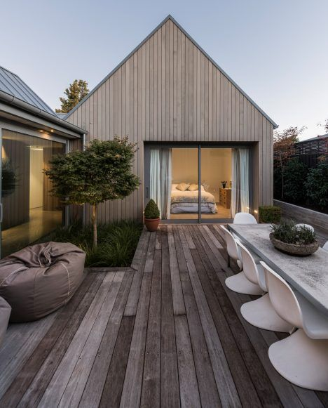 House-shaped blocks and courtyards make up this cedar-clad residence in…