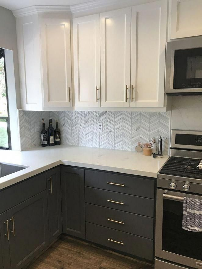 Kitchen with 2 tone white upper cabinets and dark gray ...