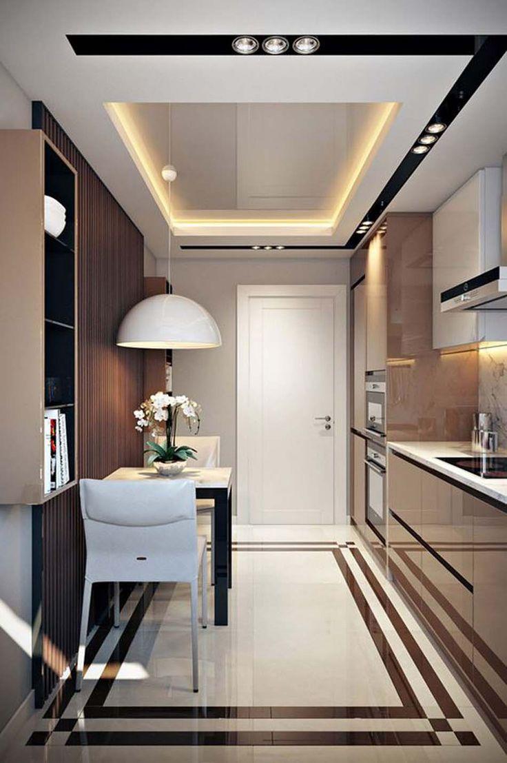 Petite cuisine d'appartement et petit coin repas pour deux personnes
