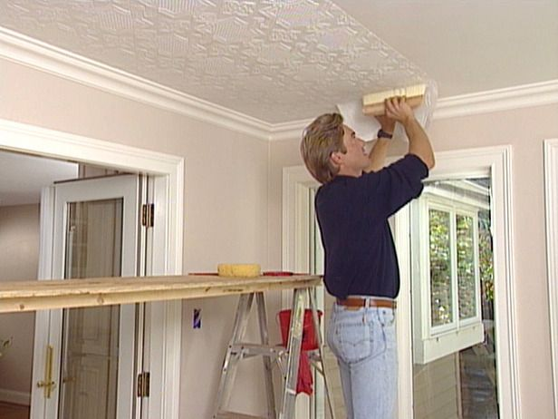 How to apply an embossed wallpaper ceiling treatment How to disguise wood paneling