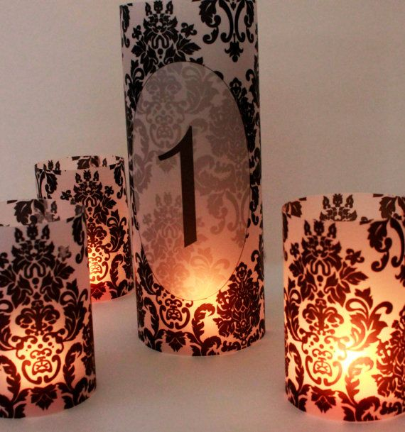 Black and White Damask Luminaries are the perfect addition to your wedding decor and tables. The short luminaries are sold in a set of 10, but you can request a custom listing with a specified quantity.  These shorter luminaries are approximately 4 inches tall and 2.75 inches in circumference. They can be perfectly paired with the matching tall luminary or table number luminary to make the perfect complete centerpieces. (Both listings can be found at the bottom of this page.) Or use the to…