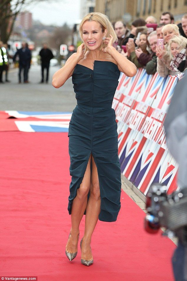 Daring: Amanda Holden sported an equally fashion forward look, donning a navy number with ...
