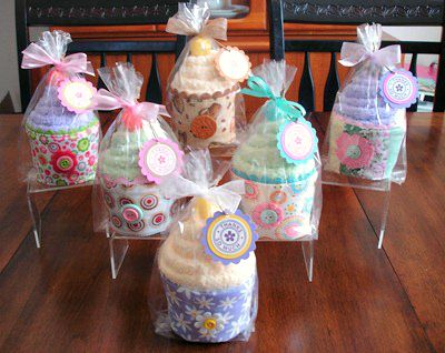 Spa Sock Cupcakes-use a cup cozy for the bottom, a pair of spa socks for the frosting, and the cherry on top is a lollipop