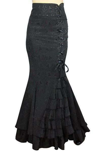 This black gothic skirt is mermaid silhouette hugging the thighs and flaring from the knee. It has a broad waistband and hascorset ribbon lacing down the side from toabove the knee, and below is a cascading set of ruffles.