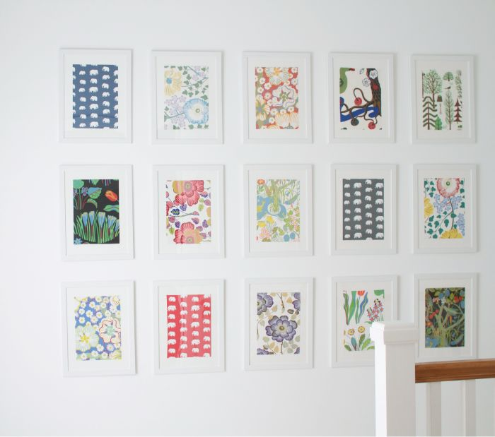 hallway gallery wall - frame wallpaper samples to add pops of color.