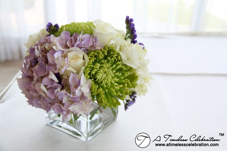 Short wedding flower centerpiece white lilac and roses