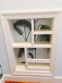 Kitchen & Bath Express Bathroom Project - Toilet Room Organizer custom built and lined with Cole and Son Palm Leaves wallpaper