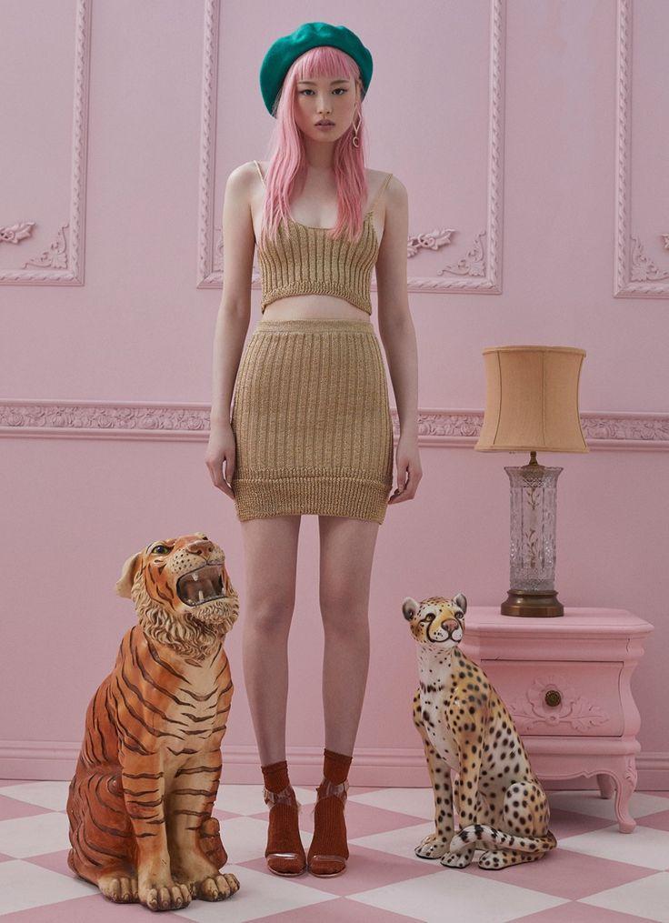 Model Fernanda Ly poses in For Love & Lemons Knitz ribbed knit top and skirt