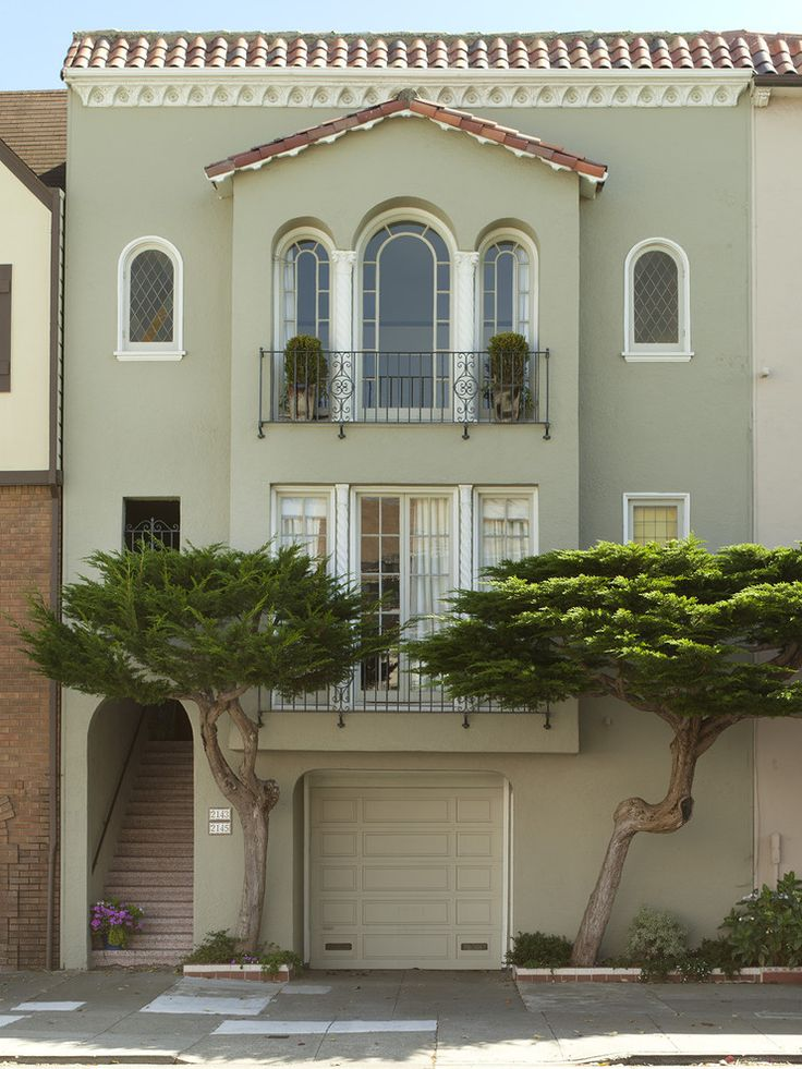 Sage y green stucco white windows exterior color for Spanish style exterior