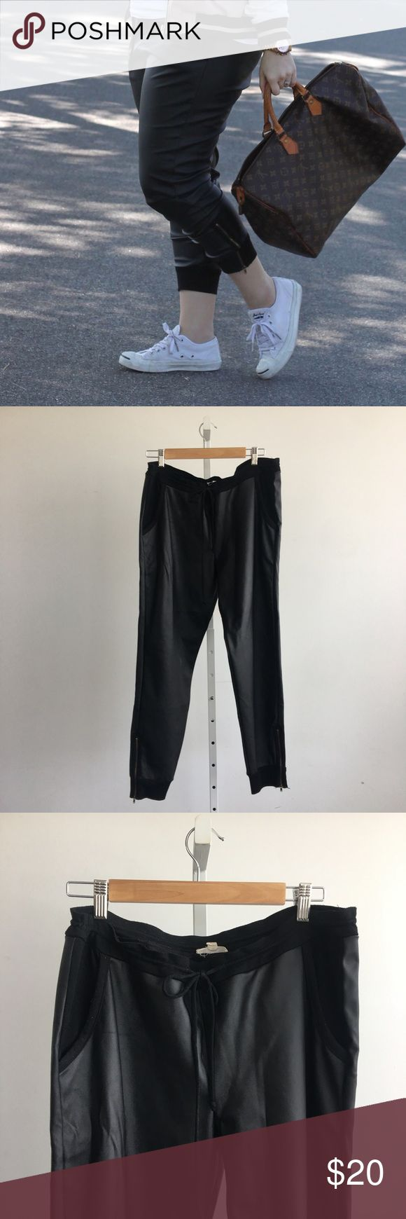 Black Faux Leather Jogger Pants Faux leather jogger pants with drawstring waist, pockets, and zipper at ankles. Worn, but in good used condition. Please carefully review each photo before purchase as they are the best descriptors of the item. My price is firm. No trades. First come, first served. Thank you! :) Pants Track Pants & Joggers
