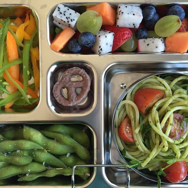 This beautiful lunch by Aviva Wittenberg is in a stainless steel bento box from PlanetBox. Todays lunch: fruit and vegetables, wholewheat with vegan dairyfree and nutfree pesto, pea shoots, edamame, peppers and sugar snap peas. www.PlanetBox.com