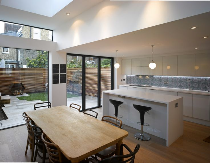 Lovely combination of bi-fold doors and high level glazing, sleek handle-less kitchen and warm wood. CLICK http://www.hollandgreen.co.uk/house_extensions/kitchen_extensions#.VAChPDJdU7k to see if you could have a similar kitchen extension.