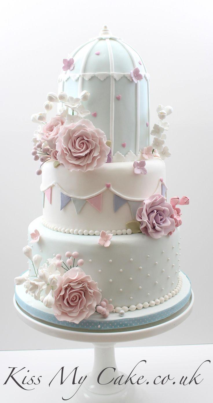 Pretty Birdcage wedding cake, with sugar bunting and flowers. www.kissmycake.co.uk