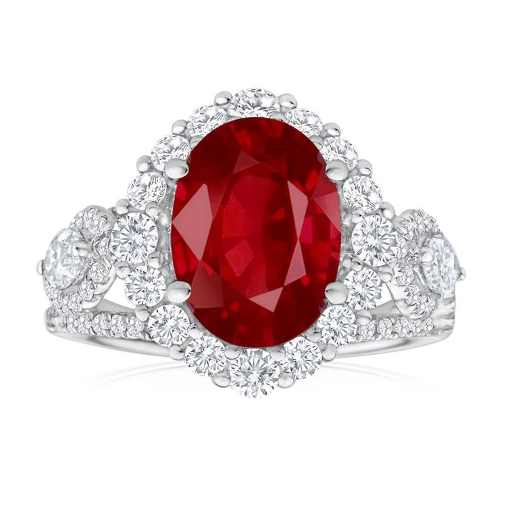 Beautiful dress ring with sparkling Ruby centre stone and Diamond halo. Would make a stunning and unique idea for an Engagement Ring
