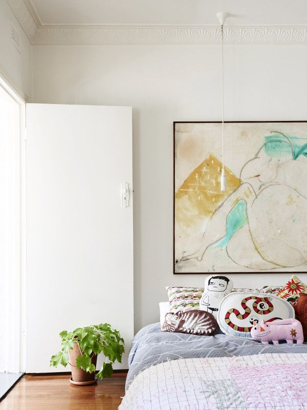 Bedroom.  Matlock Griffiths painting above the bed, cat/vase/snake pillows by Ellie King, throw by Ruby Hoppen. Photo – Eve Wilson, Production – Lucy Feagins / The Design Files.