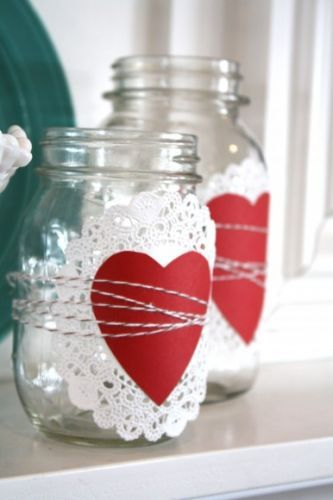 Mason jar, doily, twine and hancut heart.  Would be fun used as drinking glasses at a party.  Instead of the heart, wrap the jar with kraft paper and guests can write their names on them.  Set them out on a tray and serve with straws and a sharpie marker for writing the names.