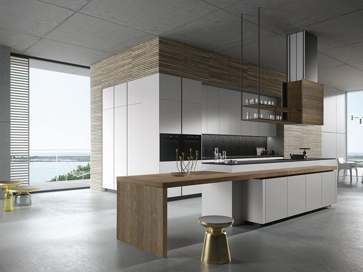 Look with cosmic matt lacquered grey panel doors and absolute black satin granite top. Counter and hood covered with sepia oak.