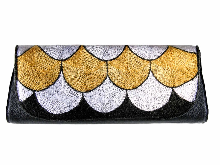 Bubbles gold-clutch. Pattern by Susanna Vento, product by Mum's. Embrodered in the hands of South African ladies.