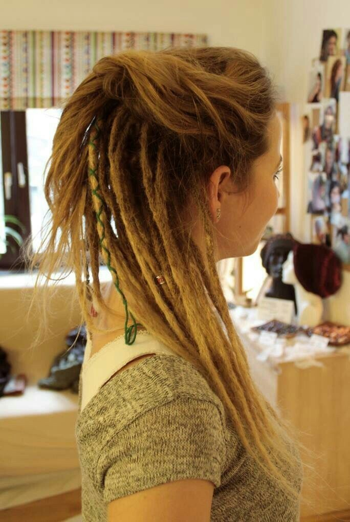 White girl with bottom half of head in dreads and top half regular