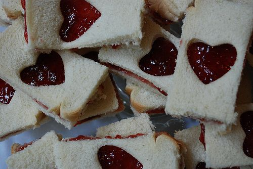 Jelly sandwiches with heart cut out on front piece.