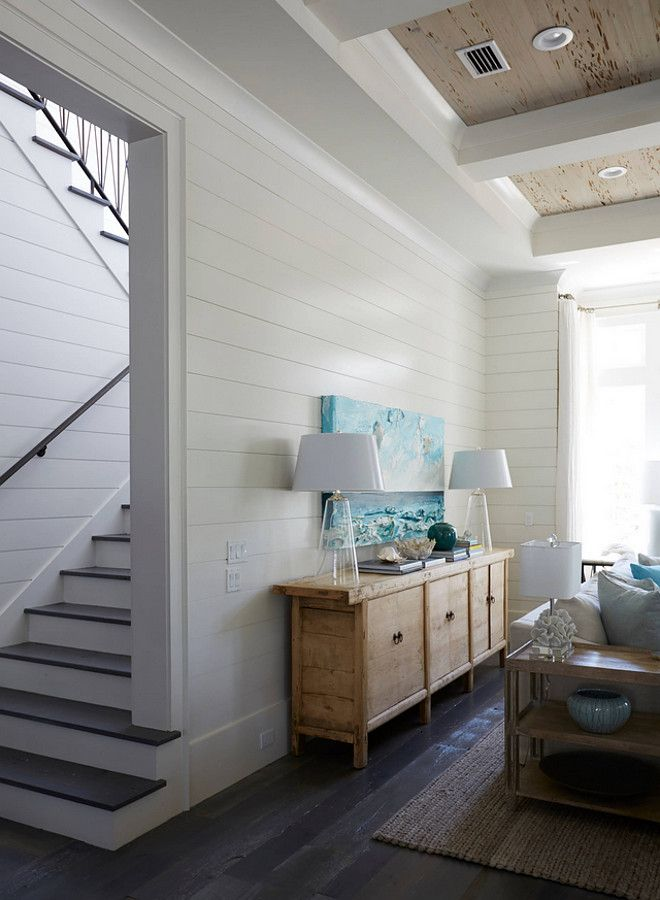 I love the contrast the dark hardwood flooring creates against the white shiplap walls. white-shiplap-walls-with-dark-stained-floors Geoff Chick & Associates