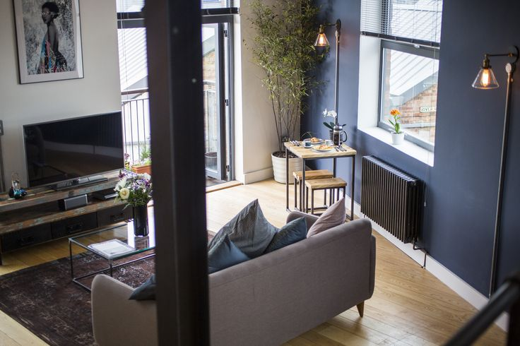 Vintage insustrial river loft apartment. Fading world aged rug, custom built wrought steel coffee table, beautiful artwork by Hush, Nubian Princess  https://www.airbnb.co.uk/rooms/6347144